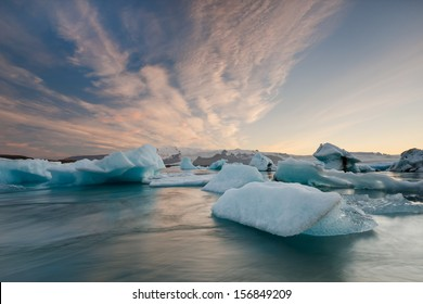 Icebergs in Jokulsarlon glacier lake at sunset in Iceland / Jokulsarlon