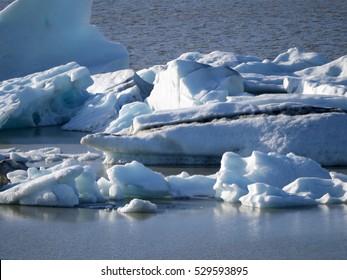 Icebergs in Jokulsarlon lagoon, beneath Breidamerkurjokull glacier, Iceland