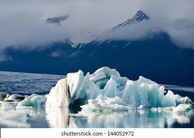Icebergs, jokulsarlon lagoon, Iceland. Glacier and mountains in the background