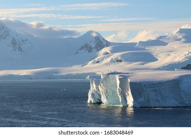 Icebergs and mountains. Sunset lights in the coast of the Antarctic Peninsula, Danco Coast, Antarctica