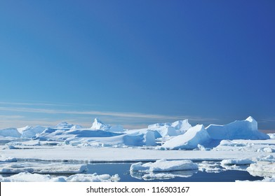 Icebergs and ocean. Peculiar landscape of the Antarctica.