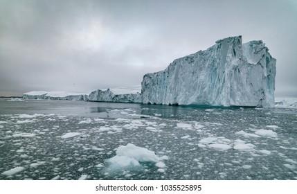 Icebergs on arctic ocean in Ilulissat icefjords in Greenland