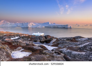 icebergs on the arctic ocean with sunset in Ilulissat, Greenland