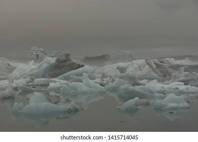 Icebergs panorama in a grey foggy day