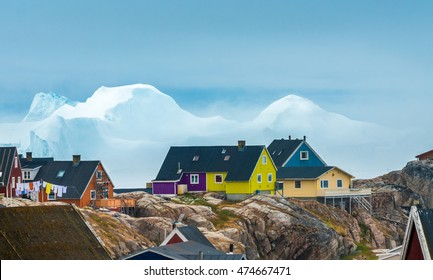 Icebergs stranded on the rocky beaches of the city center of Iulissat, Greenland