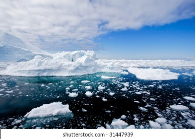 Icebergs in a wide perspective in the fjord of Ilulissat, Greenland.