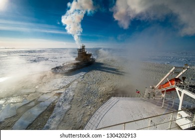 Icebreaker in a foggy ice canal escorting the LNG vessel sailing out of the port limits.