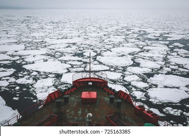 Icebreaker going through the ice fields, Arctic