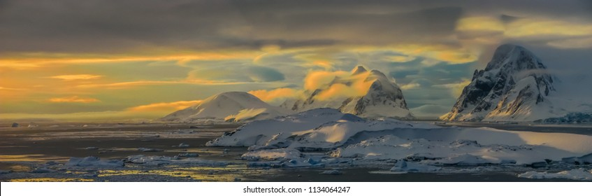 Ice-covered ridges at twilight at the base of Antarctic Peninsula. Shot from the Galindez Island, 2008.