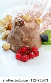 Ice-cream with chocolate and wood nuts
