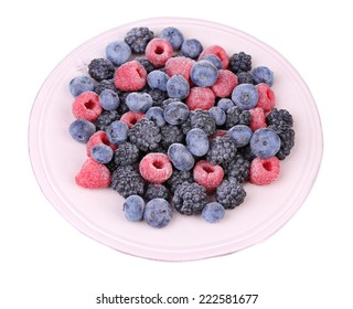 Iced berries on plate, isolated on white background