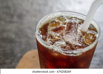 Iced black coffee on wood background