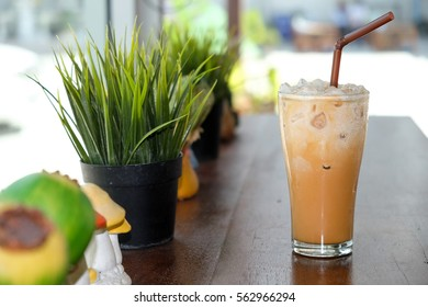 Iced cappuccino coffee on wooden table in coffee shop and coffee break