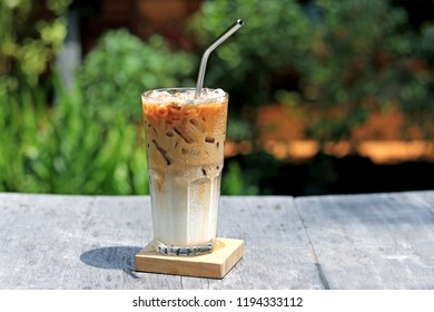 Iced caramel macchiato coffee in glass with stainless steel straw for drink.  Concept for reduce plastic pollution and support green eco friendly products. selective focus
