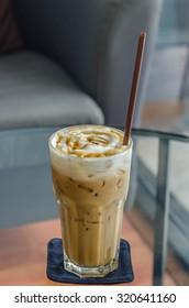 iced caramel macchiato , coffee in glass with drinking straw