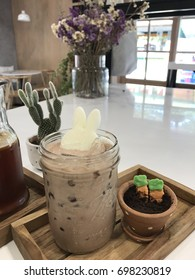 Iced chocolate with rabbit ice cube and eatable carrots