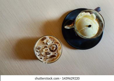 Iced coffee and affogato (Italian coffee-based dessert) on desk. Top View.