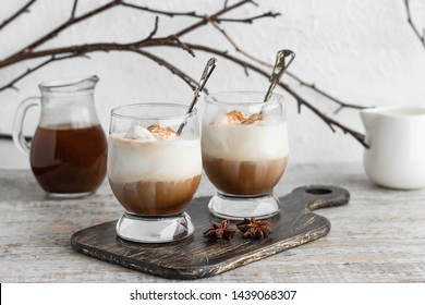 Iced coffee affogato with vanilla ice cream and cinnamon on a light background