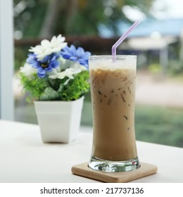iced Coffee with artificial flowers Reap in a coffee shop.