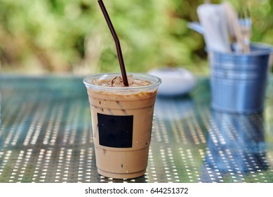 Iced coffee or caffe latte in takeaway cup.