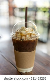 Iced coffee with caramel syrup and whipped cream