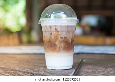 Iced Coffee, cold coffee , Latte, Capuchino, Espresso in takeaway cup on wooden table.