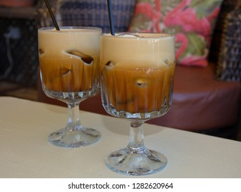 iced coffee in a glasses with sipper