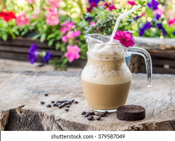 Iced coffee in jug, jar, mug glass cups on the table.