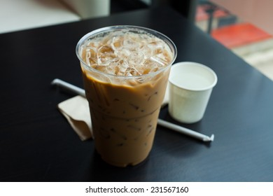 Iced coffee latte on wood table.