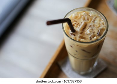 Iced coffee latte on wooden table.