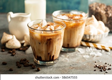 Iced coffee with milk, chocolate syrup and meringues.