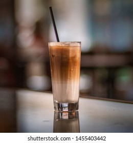 Iced coffee with milk on restaurant table