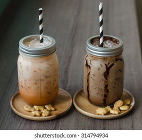 Iced coffee with milk in vintage jar