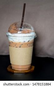 Iced coffee mocha with foam milk in takeaway cup