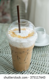 Iced coffee near window of coffee cafe