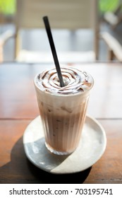 Iced coffee on old wooden table.