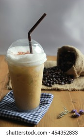 Iced coffee on wooden table, Still Life style