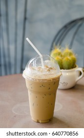 Iced coffee on wooden table background