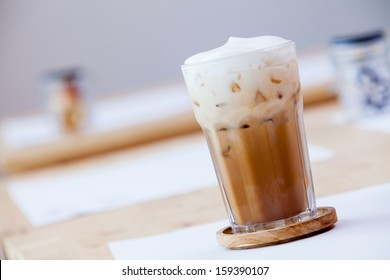 Iced coffee with soft cream on table