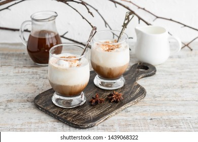 Iced coffee with vanilla ice cream and cinnamon on a light background