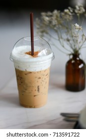 Iced coffee whipped milk  in coffee shop on table