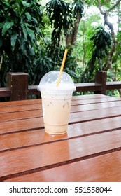 iced coffee in wooden table