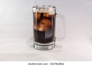 An iced cold mug of soda