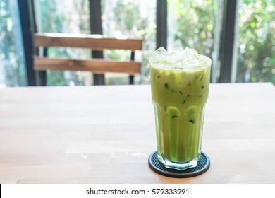 iced green tea latte in cafe