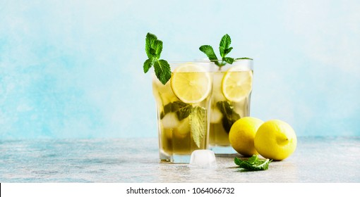 iced green tea with lemon and fresh mint .Copy space