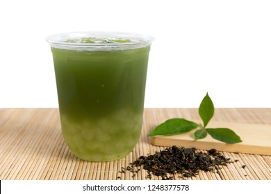 Iced green tea with Tapioca Pearls on wooden background