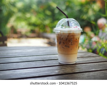 iced latte coffee with milk cream in the plastic cup