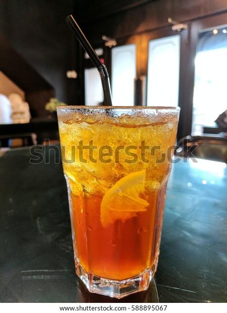Iced lemon tea on black table