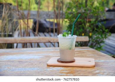 iced lemon water on wood table (Style Still Life)