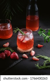 Iced lemonade with starwberry and rosemary